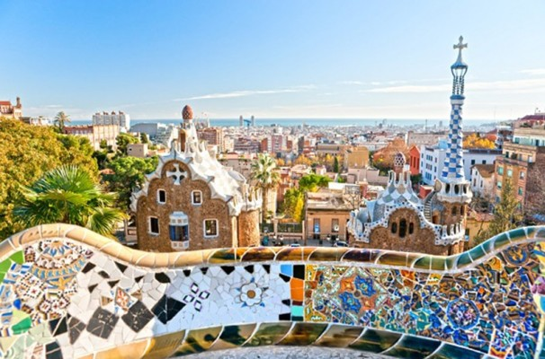 balcony in Park Guell in Barcelona, colourful tiles and rooftops in view