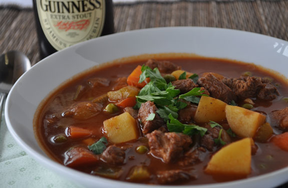 Irish beef stew with a bottle of Guinness