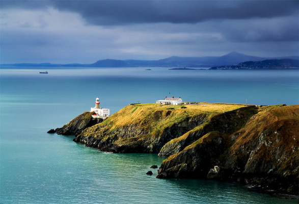 coastal cliff scene in Howth, Dublin, with lighthouse