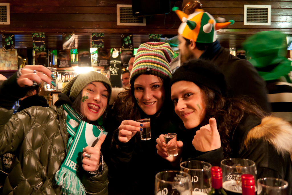3 girls having fun and drinking in Dublin pub
