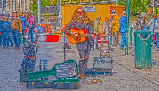 street musician nusking on Grafton Street in Dublin