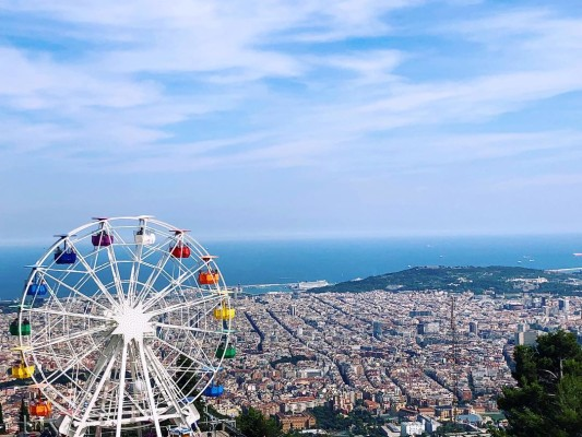 View of amusement park ferris wheel on Mount Tibidabo in Barcelona