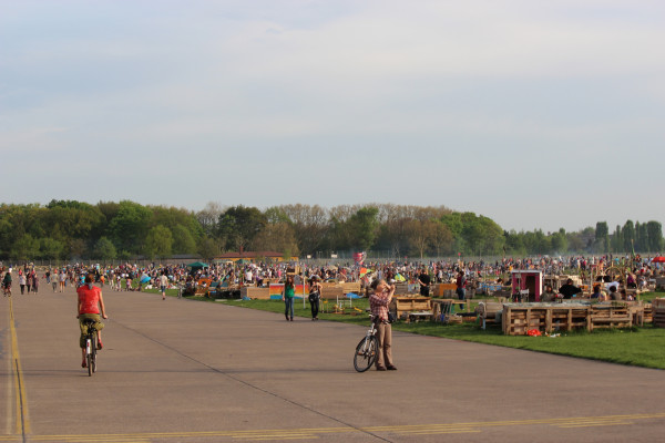 A busy Tempelhofer feld, old TempleHof airport, in Berlin with many people enjoying it for recreational use