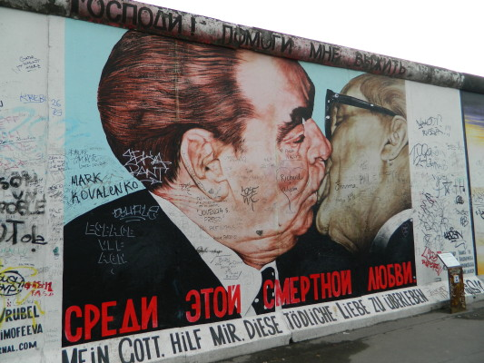 Graffiti art by Dimitri Vrubel entitled My God, Help me to Survive This Deadly Love, also know as 'the fraternal kiss' on the Berlin Wall as part of the East Side Gallery exhibit