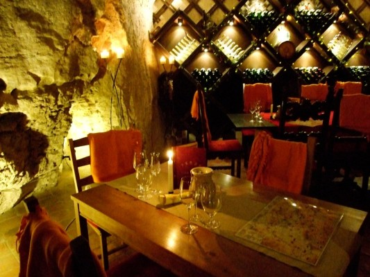 candle-lit tables in the intimate Faust Wine Cellar in Budapest