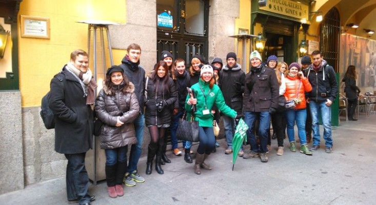 Tatiana, a city tour guide in Madrid, with her group of tourists during a free walking tour