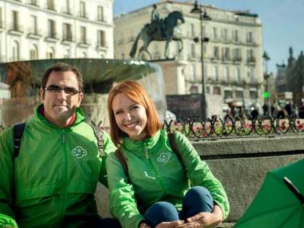 OgoTours Madrid free walking tour founders, Tatiana and Javier sitting at Plaza Mayor in Madrid