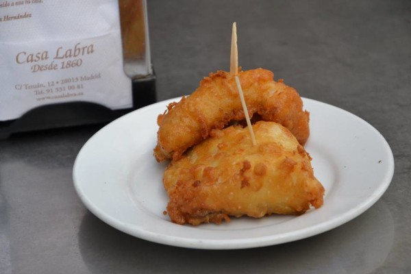 Two pieces of crispy bacalao, a fired cod dish, as presented at Casa Rua restaurant in Madrid