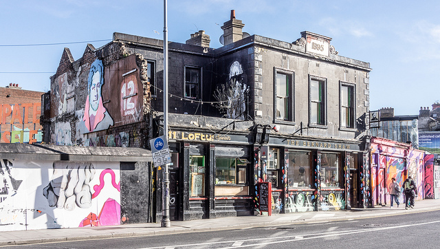 Exterior of the Bernard Shaw Pub in Dublin in daylight with graffiti and urban art