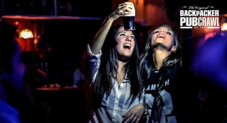 Two girls on a pub crawl in Dublin, Ireland, having fun and enjoying drinking Guinness