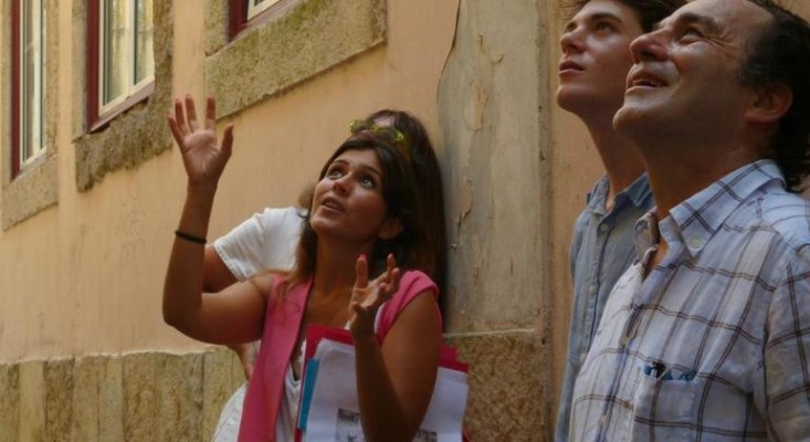A Lisbon city tour guide showing tourists an unseen iconic site during a free walking tour in Lisbon
