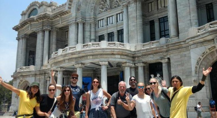 A group of tourists on a free walking tour in Mexico City with local professional city tour guides
