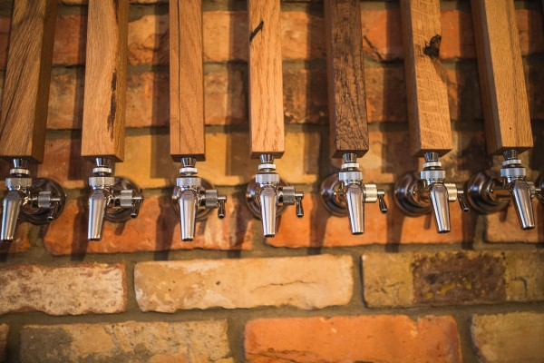 Five nozzles of beer taps as seen in Muted Horn bar in Berlin, Germany