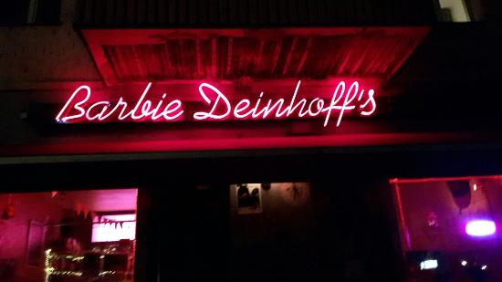 The name barbie deinhoffs in pink neon over the entrance to barbiedeinhoff's bar in Berlin