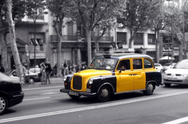the typical black and yellow taxi in Barcelona