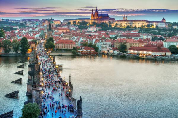 Prague skyline and charles bridge at dusk