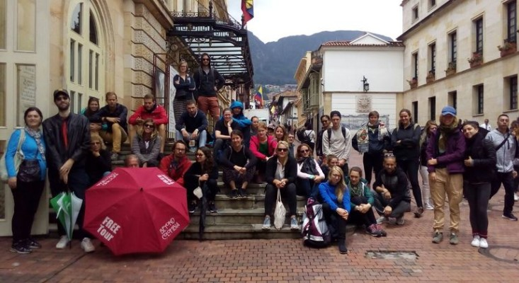 Group of tourists with their tour guide on a city tour in Bogotá, Colombia