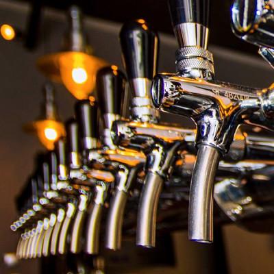 A series of beer taps in Nubeerbar in Prague