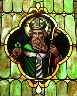 Stain glass depiction of Saint Patrick with shamrock