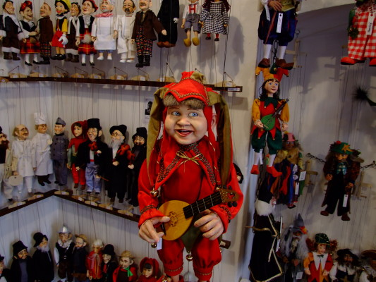 A selection of puppets and marionettes in a Prague souvenir shop