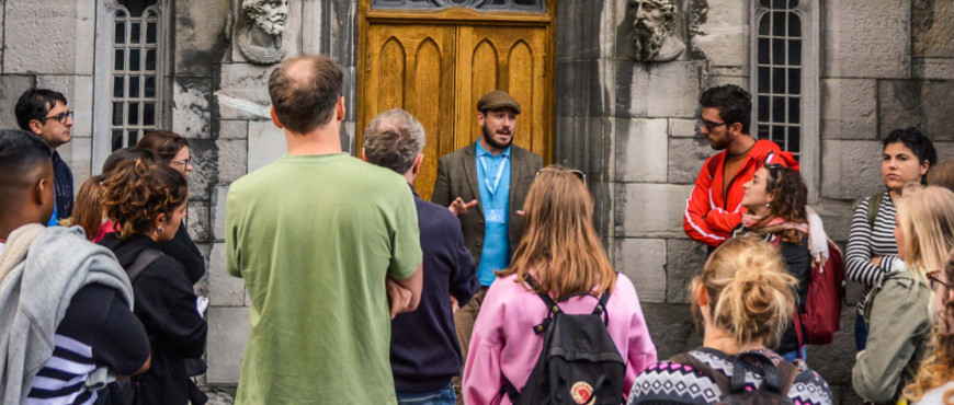 A tour guide in dublin tells tourists all about the mythology and folklore of ireland on a free walking tour in Dublin