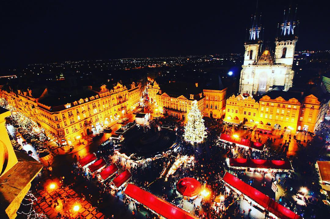 Ariel view of prague christmas markets in old town square at night