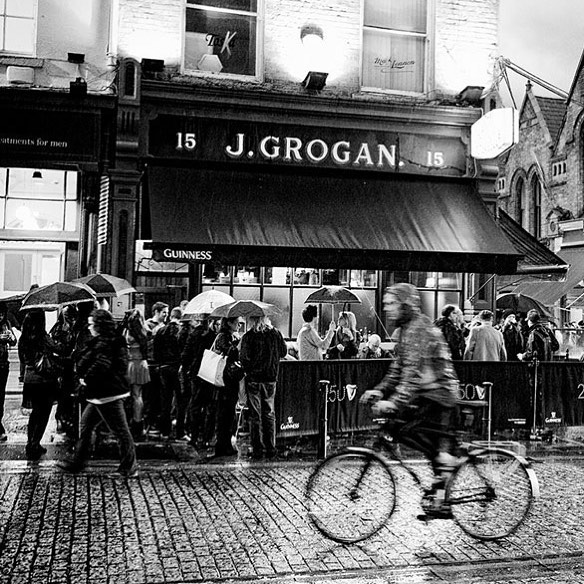 exterior of Grogans pub Dublin on a wet day in black and white