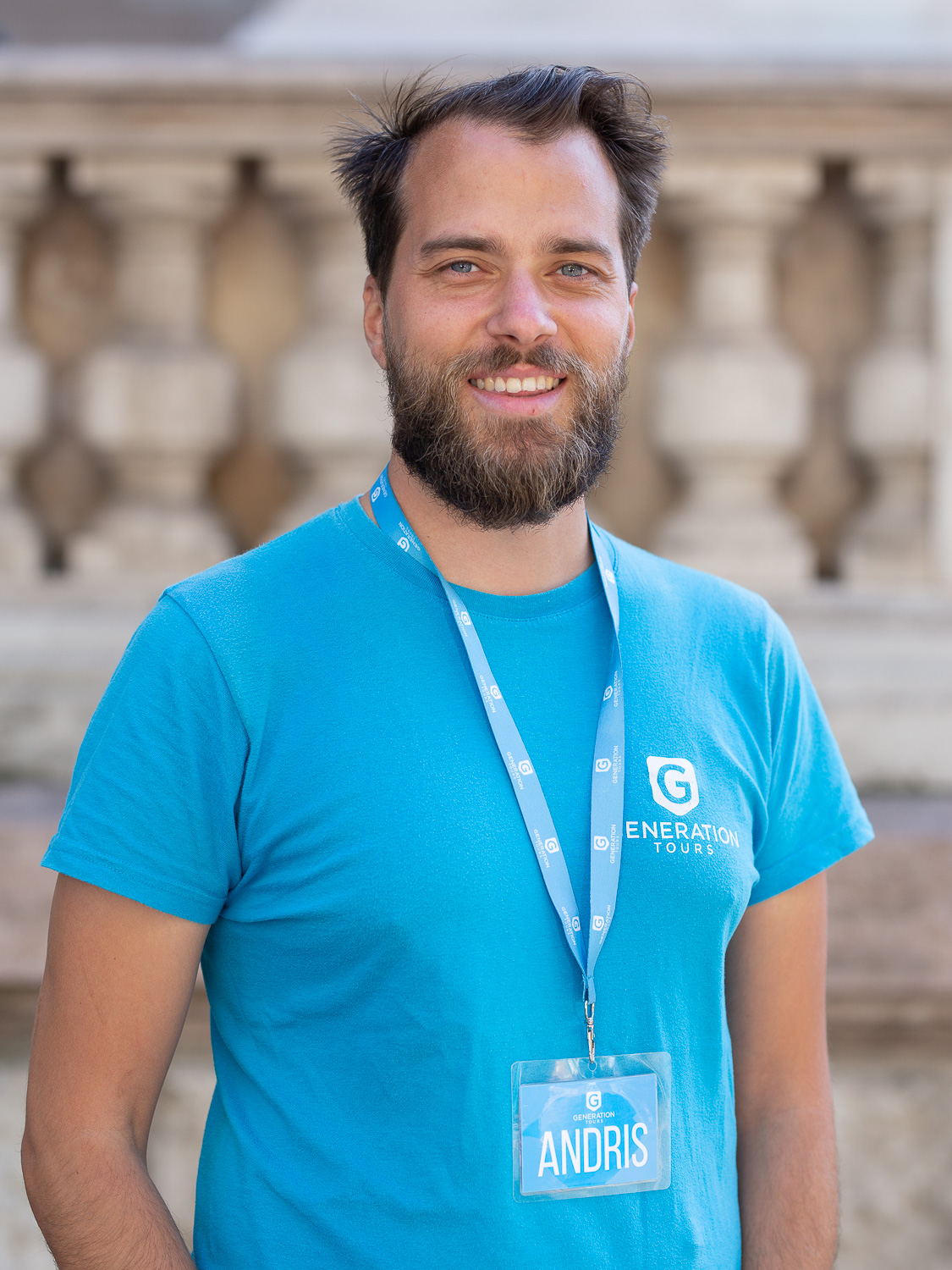 A Generation Tours free Budapest walking tour guide in blue t-shirt In front of St. Stephen's Basilica