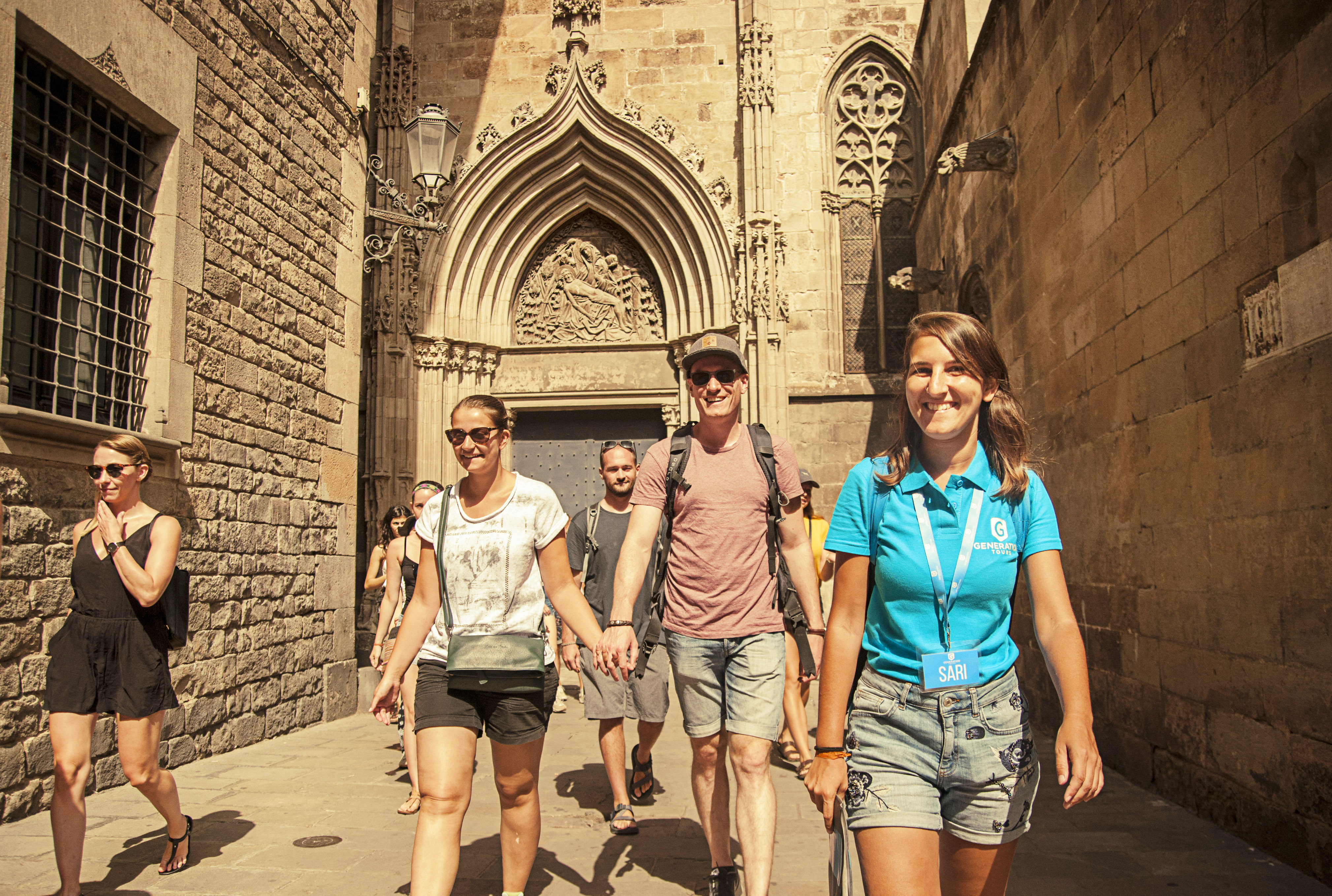 tourists and tour guide on a free walking tour in Barcelona