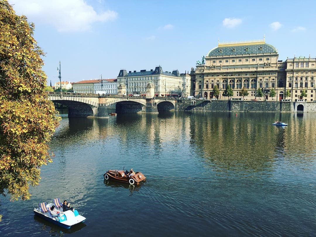 Paddle boats on the Vltava river in Prague