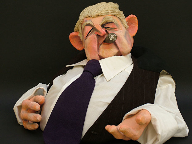 a Puppet of a man smoking a cigar from the Berlin puppet theatre museum