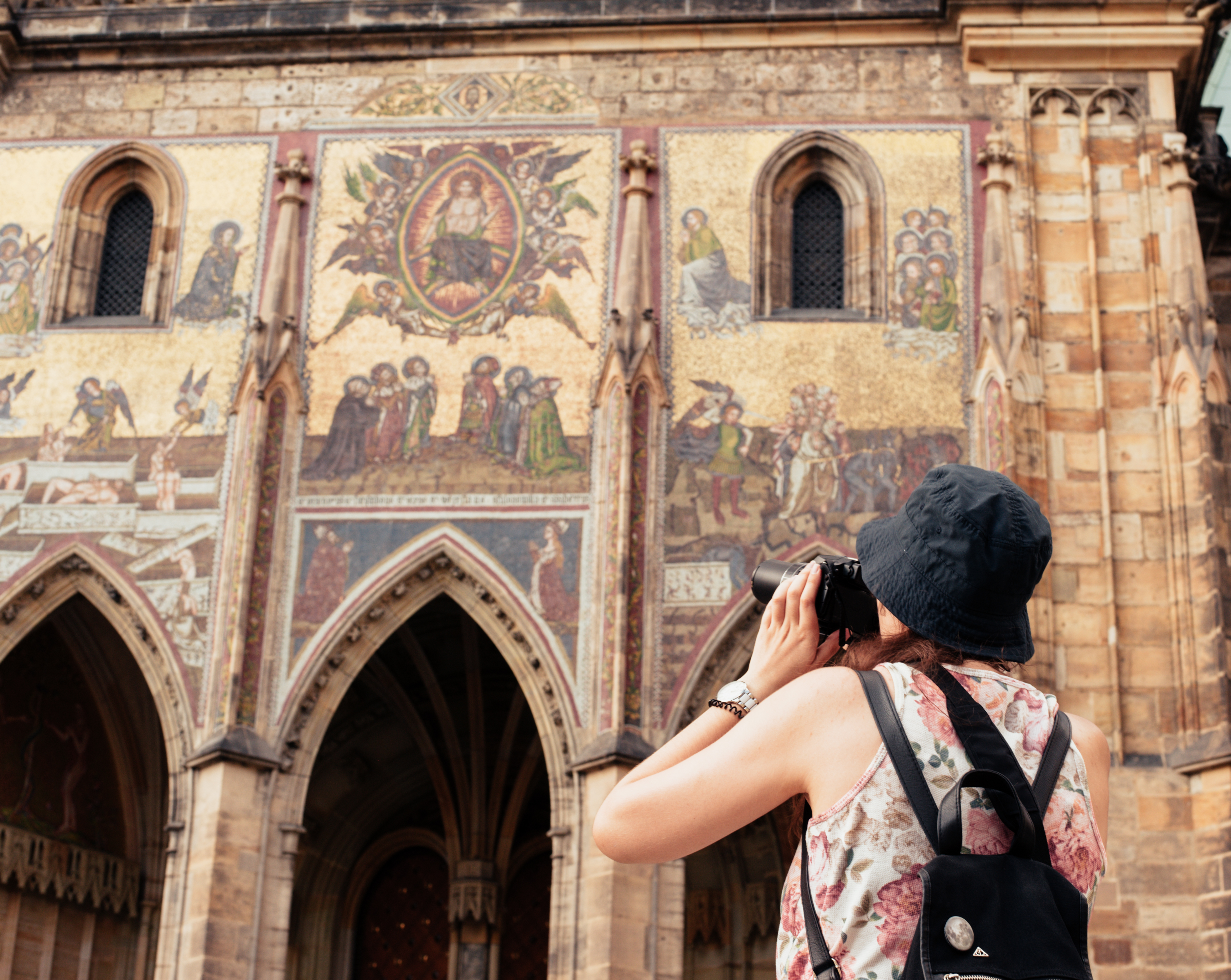 A tourist takes a photo of a wall in prague