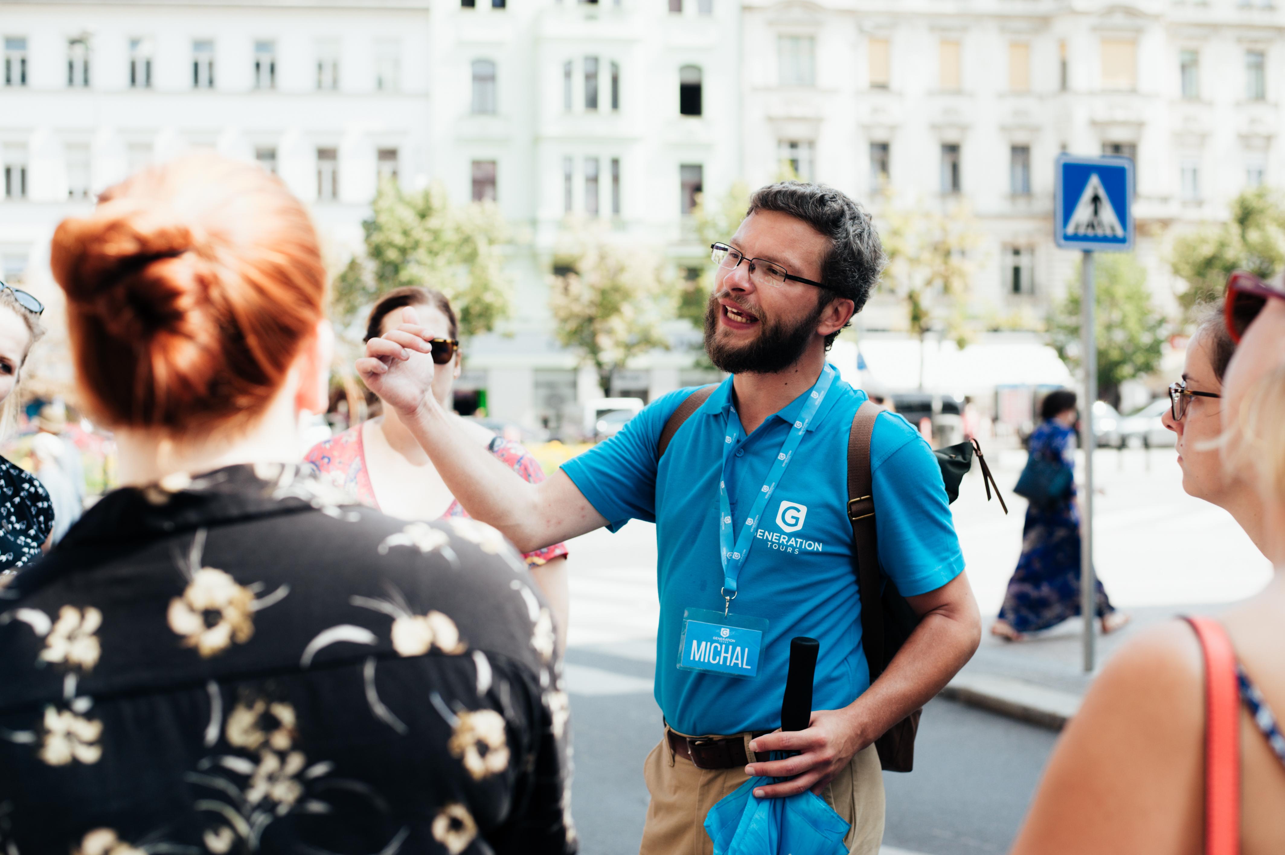 A free walking tour of Prague guide explaining a sight to tourists
