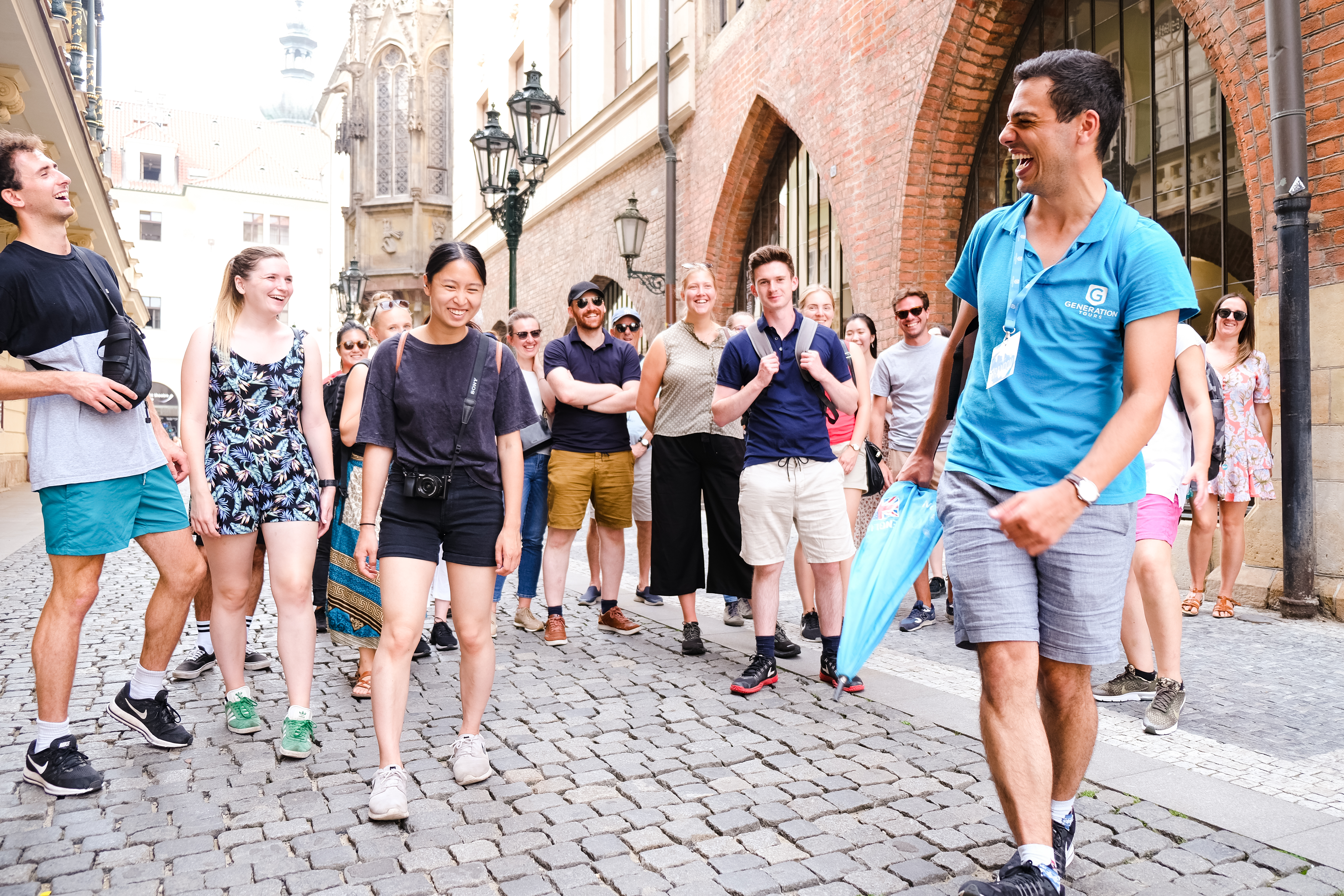 A free tour guide in Prague with a group of tourists on a Prague city tour
